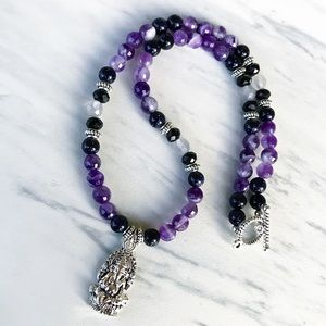 Genuine diamond cut amethyst ganesh necklace